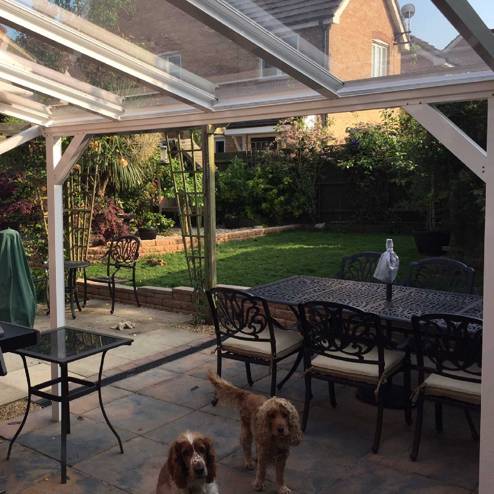 Affordable Omega Smart White Lean-To Canopy with 6mm Glass Clear Plate Polycarbonate Glazing - 7.7m (W) x 2.5m (P), (4) Supporting Posts