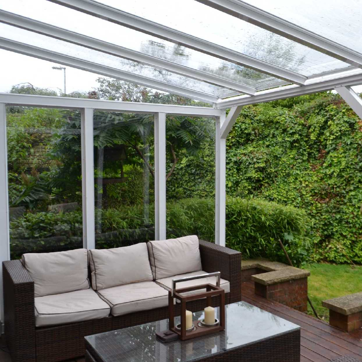Omega Smart White Lean-To Canopy with 6mm Glass Clear Plate Polycarbonate Glazing - 7.4m (W) x 4.0m (P), (4) Supporting Posts