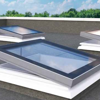 Mardome Glass Flat Roof Light powered opening with a  150mm PVC kerb