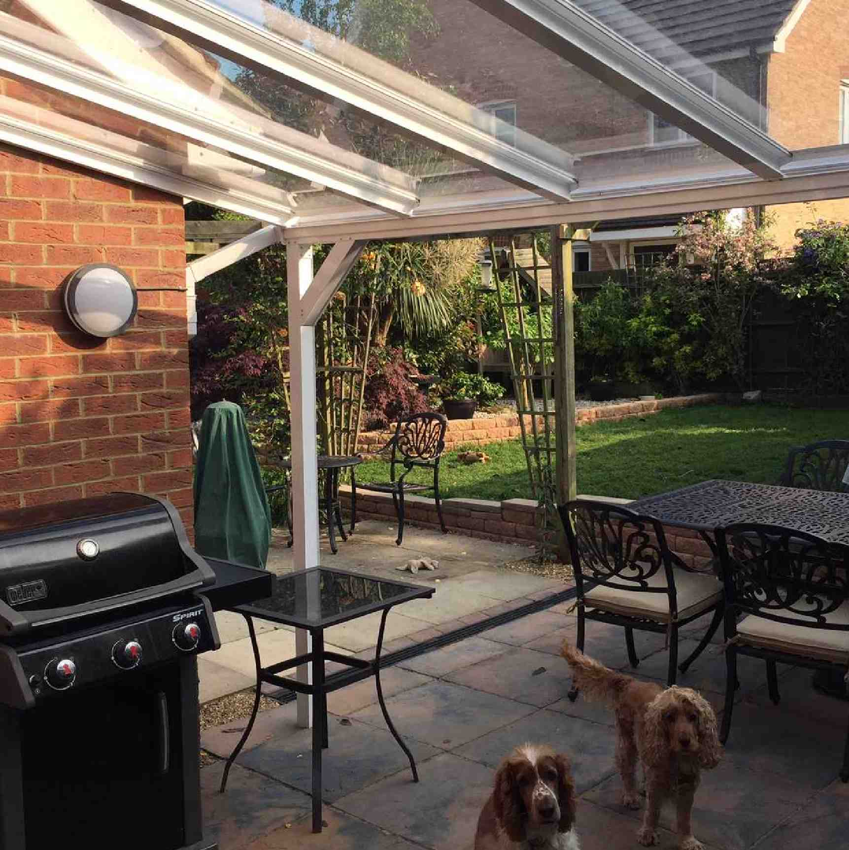 Omega Verandah with 6mm Glass Clear Plate Polycarbonate Glazing - 7.7m (W) x 3.5m (P), (4) Supporting Posts