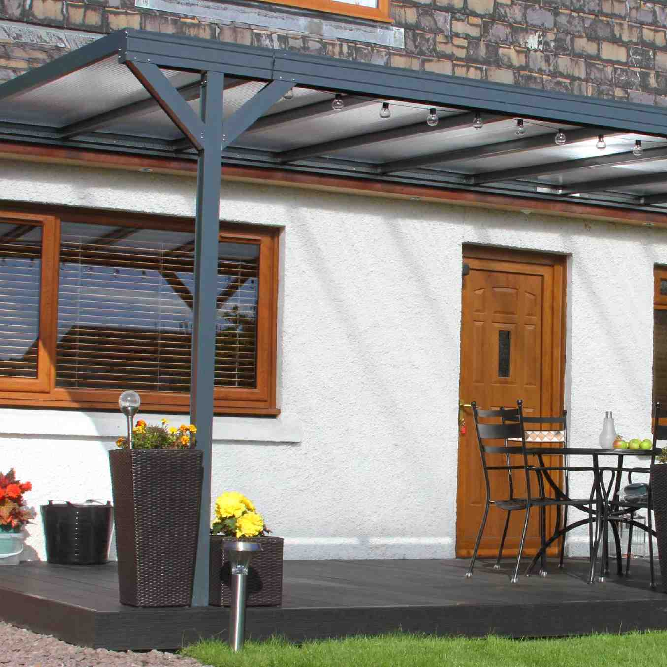 Omega Verandah, Anthracite Grey, 6mm Glass Clear Plate Polycarbonate Glazing - 7.7m (W) x 3.5m (P), (4) Supporting Posts
