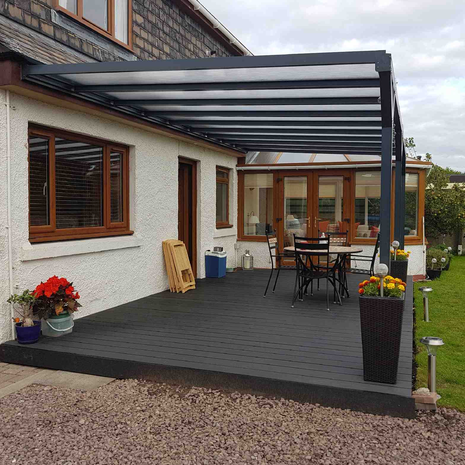 Buy Omega Verandah, Anthracite Grey, 6mm Glass Clear Plate Polycarbonate Glazing - 7.7m (W) x 3.5m (P), (4) Supporting Posts online today